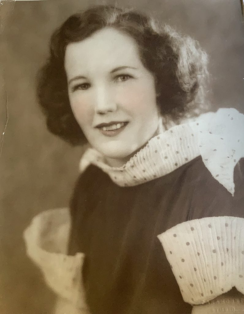 Jean robinson ( also jean frazer) a vintage photo of my nana - sepia toned and hand coloured  in a polka dot frock