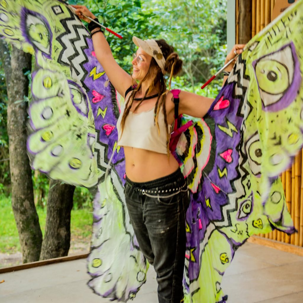Student working with moths silk wings and backback - glowfest